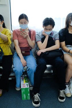 Train in East Asia with people wearing surgical face masks.