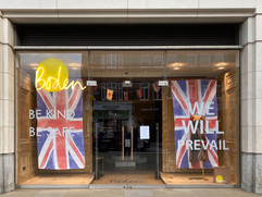 "Boden store front closed. Sign says ""we will prevail"""