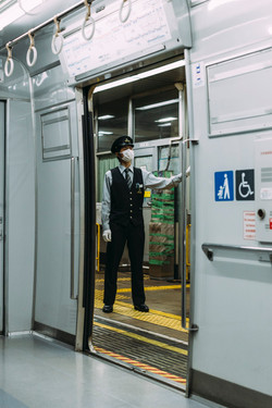 Train conductor wearing face mask.