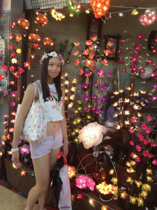 Fashionable woman in front of indoor light display.