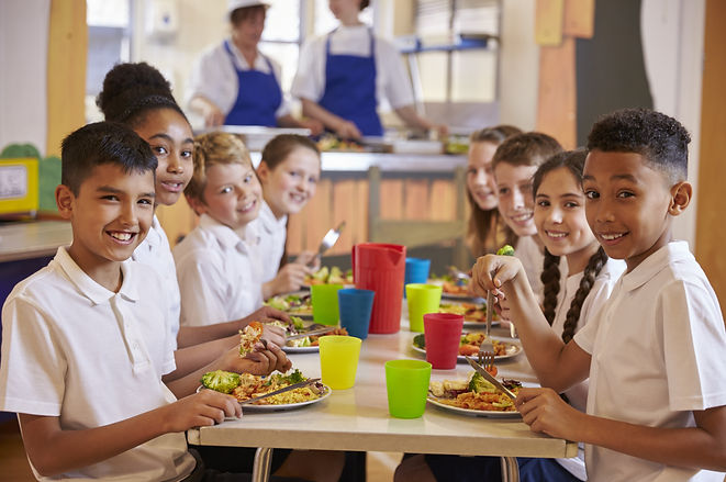 Kids at a table in a primary school cafe
