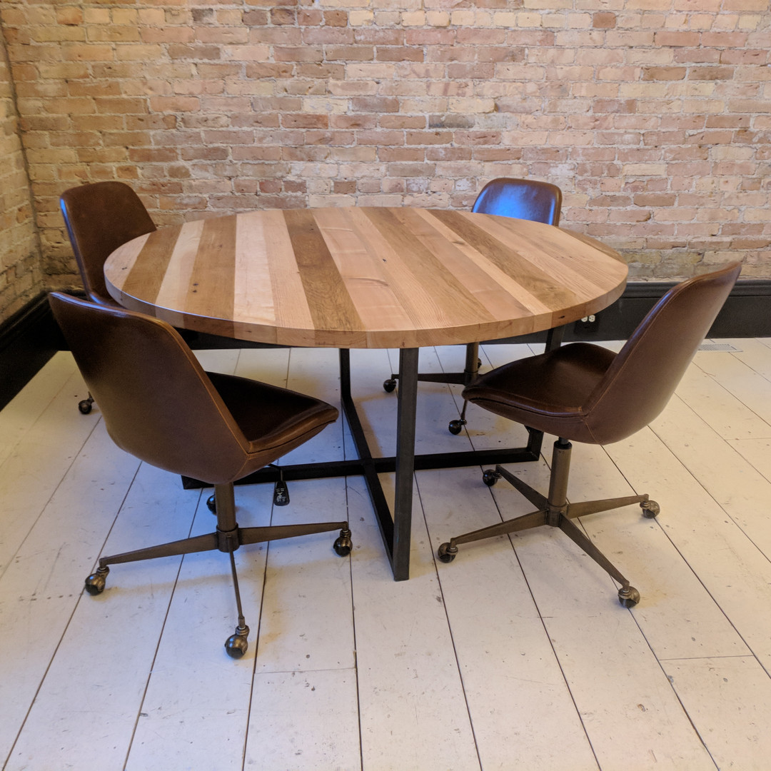 Contemporary round reclaimed wood table