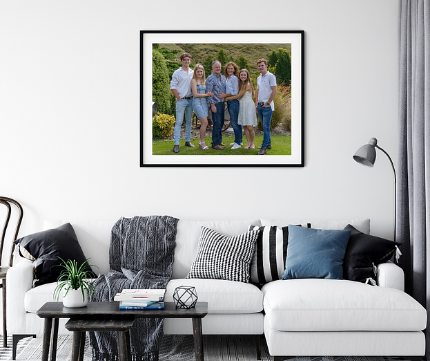 framed family photo on wall