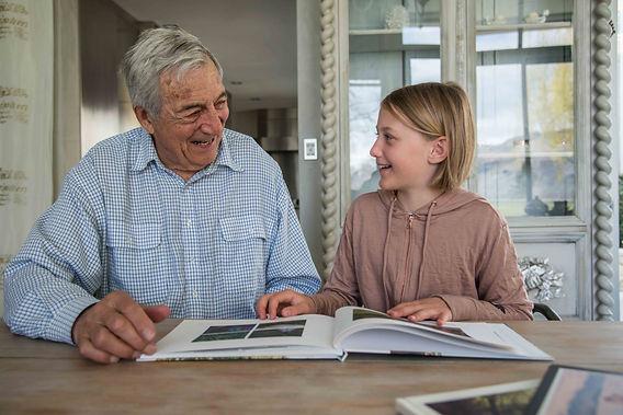 enjoying photobook with grandad.jpg