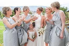 bride and bridesmaids enjoying themselve