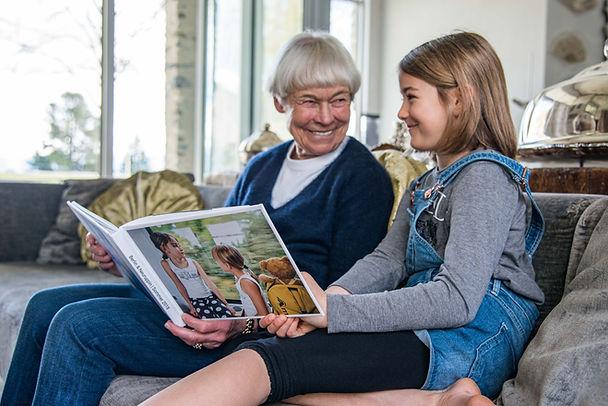 enjoying photobook and stories with gran