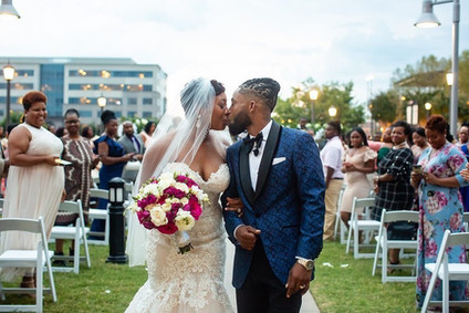 Bride and Groom share a kiss at the ceremony at the Westin in Huntsville, AL