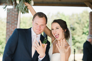 Showing off the wedding rings at Flagstone Farms