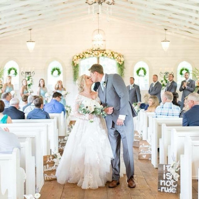 Bride and Groom Share a kiss at the end of the ceremony at Southern House & Gardens in Knoxville, AL