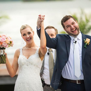 The Bride and Groom are happy at the ceremony in Lake Martin, AL