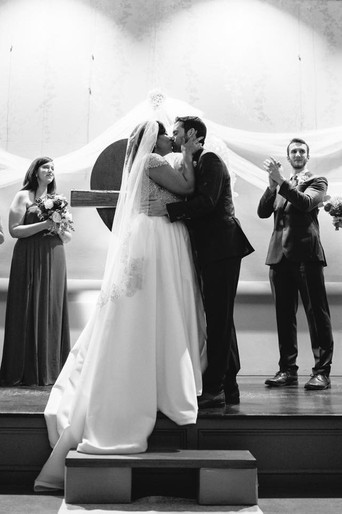 Bride and Groom share a kiss at the Birmingham Botanical Gardens