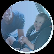 Boy in car seat smiling