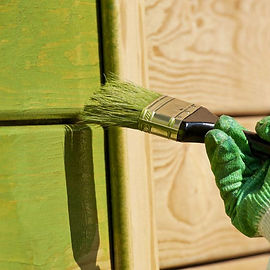 Staining the outside of a house green