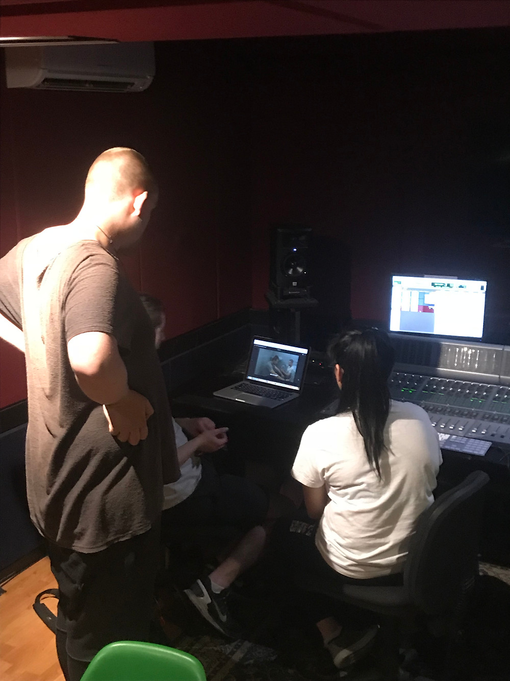 Jo and Angus recording cereal being mixed in a bowl (left) and discussing the edit with director Michael Fajgman (right)
