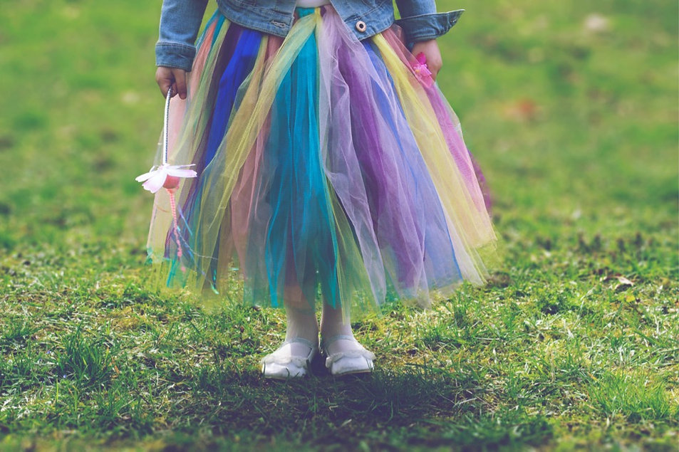 little-girl-in-colorful-tutu-skirt-stand