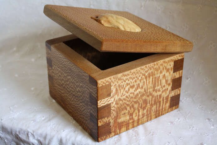 Carved box, dovetail and cockleshell