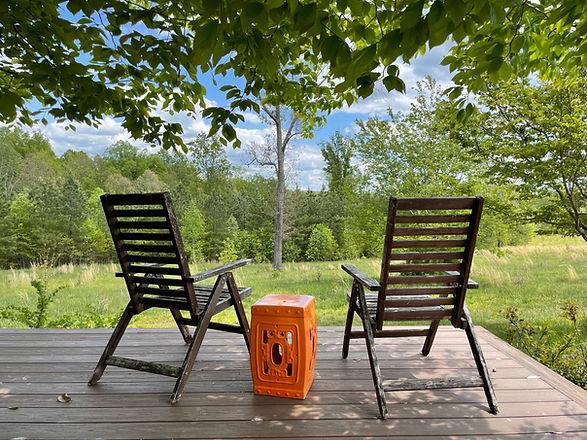 Two chairs look toward the horizon