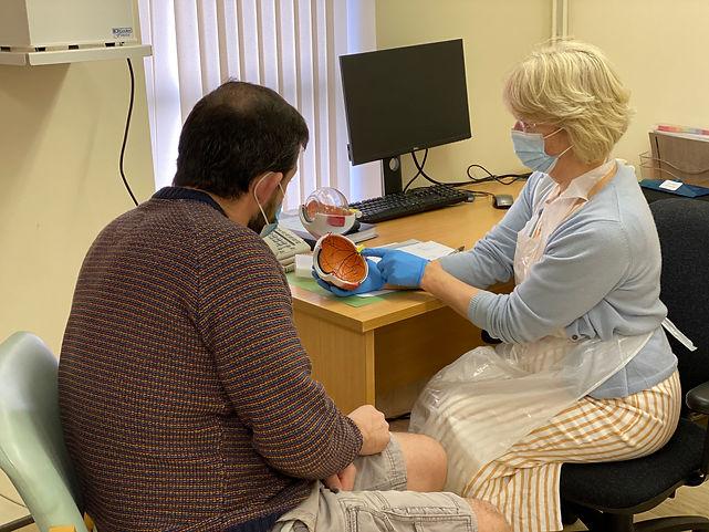 Bridget demonstrating eye to male patien