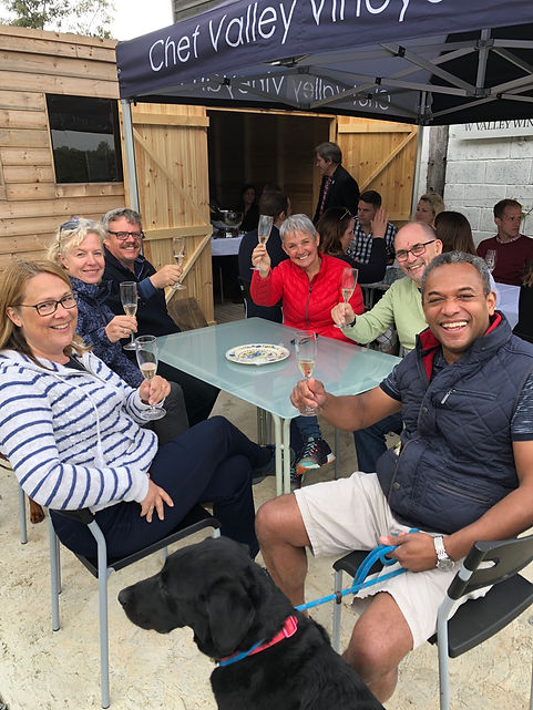 People enjoying a vineyard tour and wine tasting at Chet and Wavene Valley Vineyard