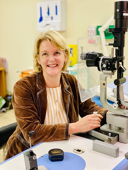 Bridget Hemmant consultant at Spire Hospital Norwich sitting at the Slit lamp