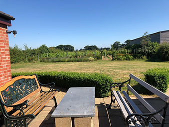 Enjoy uninterrupted views accross the garden and vineyard at The Vine House Holiday home