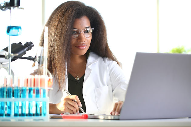bigstock-Black-Female-Chemist-Student-C-