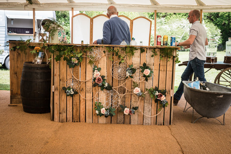 Rustic Outdoor Bar and Dreamcatcher Wall