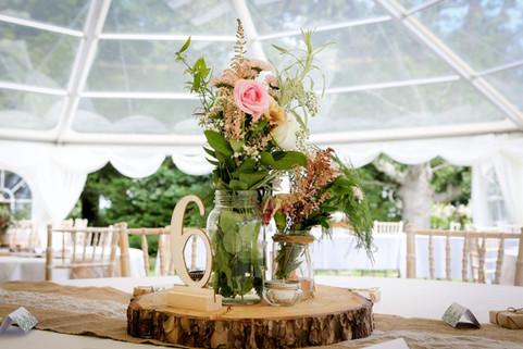 Log Slice, Rustic Vase and Flowers