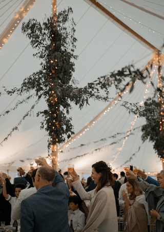Foliage and Tree Branches in Rustic Pole Tent