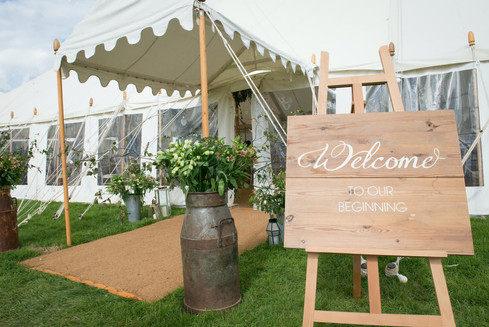 Welcome to Our Beginning Handmade Sign and Milk Churns