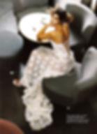 Robe de mariée Quiqui Lamothe bustier en dentelle sur organza, dos lacé, jupon nude, photo du magazine Mariages