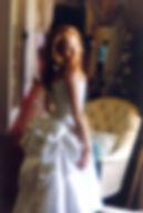 Robe de mariée Quiqubustier dos lacé en soie sauvage et son faux-cul lorsqu'on la remonte Lamothe