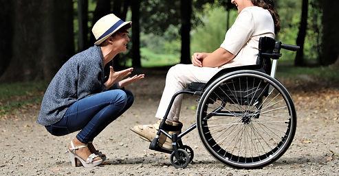 woman-on-black-folding-wheelchair-2026764.jpg