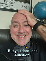 Tigger, a cis man in his mid 50s, smiling, caption saying, but you don't look Autistic