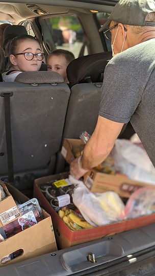 Phil loading car with kids.jpg