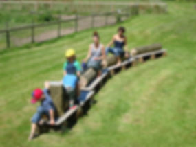 Family play at St Augustines Farm on a day out