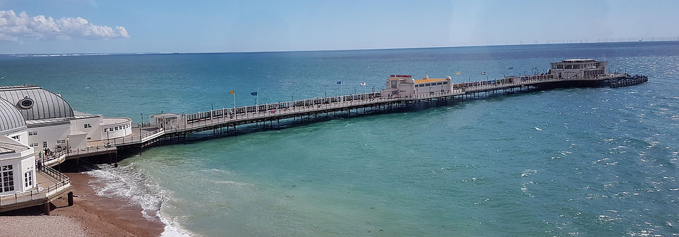 a picture of worthing pier surrounded by the sea