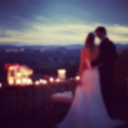 Bride and groom in front of an Italian landscape for their wedding day