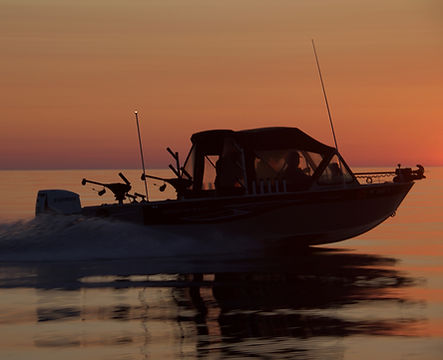Jigging and light tackle fishing in Lake Superior at sunset with Keweenaw Charter Fishing Co.