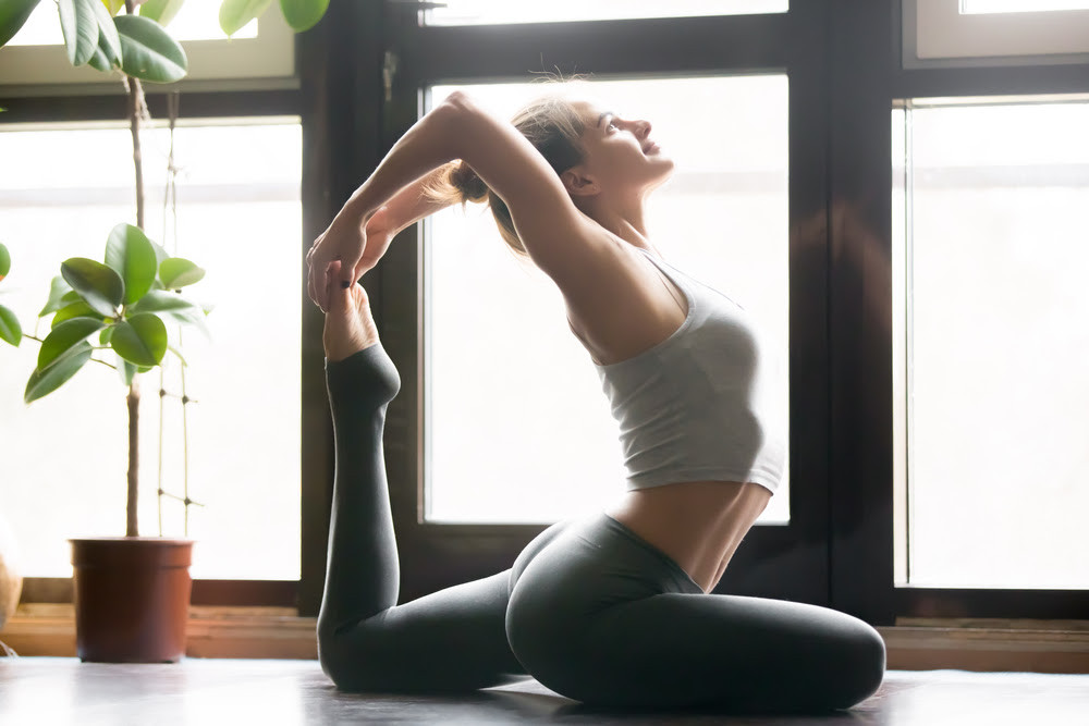 Woman in difficult yoga pose.