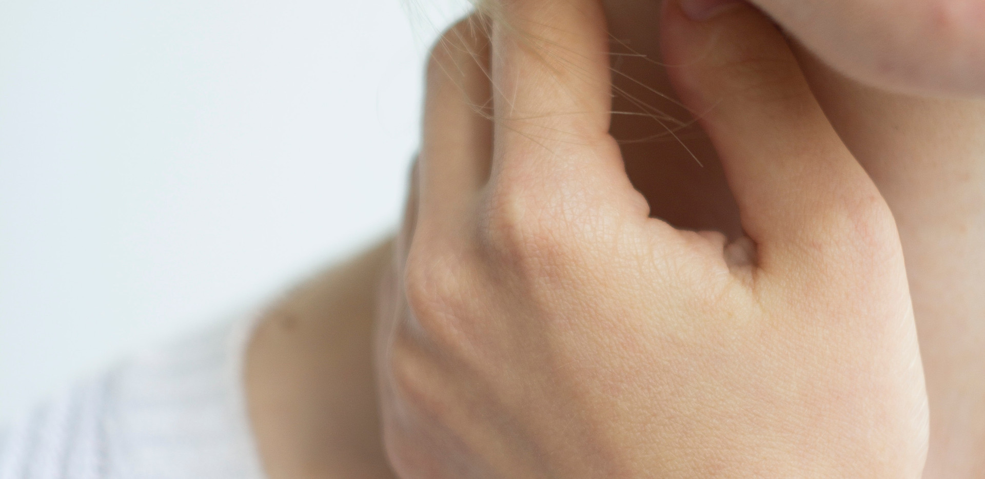 photo-of-woman-touching-her-neck-2734173
