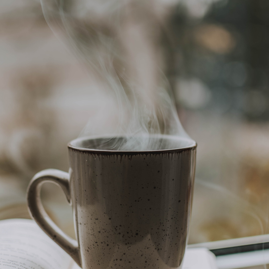 photo-of-coffee-mug-on-top-of-book-32165