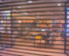 FMS - Rideau métallique vitrine de magasin en micropérforé et transparant  à nice