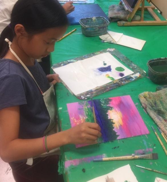 Sophia painting her sunset