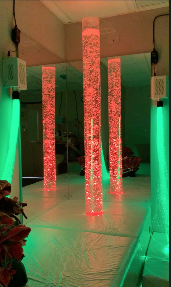 Red and green LED lights and bubble tube in dimly lit room