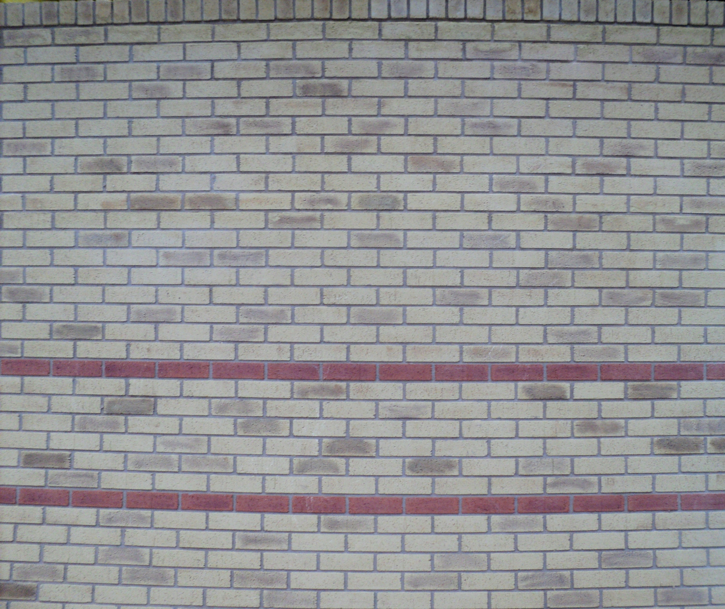 Buff brick with red stretcher band