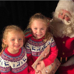 Santa meets two friends