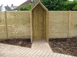 Fence paneling and timber gate
