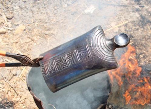 Poupée en céramique enfumée