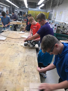 Cutting Board Students Belt Sanding.jpg
